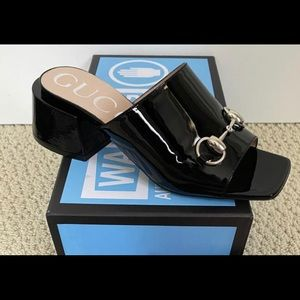 Gucci patent leather mid heel slides